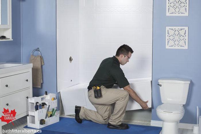 Man placing bathtub in the bathroom